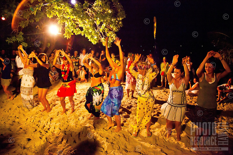 Party scene with visitors learning Tahitian dance from local dancers