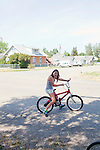 Breelyn Jensen, 11, rides bikes with her sisters on the last day of summer in Whitehall, Montana August 23, 2011. Whitehall's population was just over 1,000 in the 2000 census.
