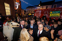 Pictured: Jeremy Corbyn arrives to Carmarthen with folk Christmas figure Mari Lwyd (horse head L) and a Plaid Cymru placard (R). Saturday 07 December 2019<br /> Re: Labour Party leader Jeremy Corbyn pre-election campaign in Carmarthen, Wales, UK.