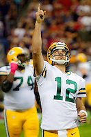 Reigning NFL MVP Aaron Rodgers celebrates one of his six touchdown passes as the visiting Green Bay Packers defeated the Houston Texans 42-24 at Reliant Stadium, Oct. 14, 2012