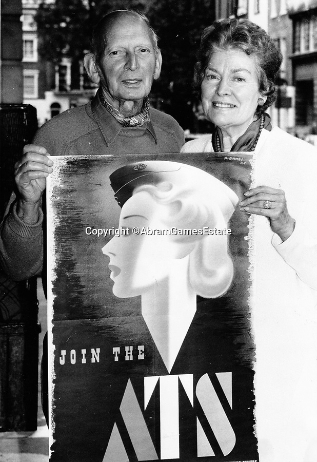 BNPS.co.uk (01202 558833)<br /> Pic: AbramGamesEstate/BNPS<br /> <br /> Reunited - Abram Games with Doreen in 1989 when another of the super rare posters was sold.<br /> <br /> Rare survivor - WW2 'Blonde Bombshell' poster that was banned for being to glamorous emerges.<br /> <br /> A rare copy of a controversial wartime poster for the women's ATS that had to be pulped following complaints by a feminist MP has come to light.<br /> <br /> The poster aimed at getting women to join the Auxiliary Territorial Army was produced in 1941 by renowned graphic designer Abraham Games.<br /> <br /> He deliberately glamourised the service by turning brunette model Doreen Murphy into a blonde, giving her red lipstick and putting her cap at a 'sexy' angle.<br /> <br /> Games' aim was to appeal to younger women but his 'blonde bombshell' poster drew complaints.<br /> <br /> Some 10,000 copies were destroyed but one that has survived has emerged for sale in Dorset for £5,000.