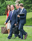 From left to right: Hope Hicks, White House Director of Strategic Communications, Steve Bannon, Chief Strategist, White House Chief of Staff Reince Priebus, and White House Policy Advisor Stephen Miller walk across the South Lawn of the White House to join United States President Donald J. Trump aboard Marine One as he departs the White House in Washington, DC en route to Harrisburg, Pennsylvania where he will participate in a Make America Great Again Rally on Saturday, April 29, 2017.<br /> Credit: Ron Sachs / Pool via CNP