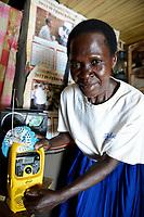 UGANDA, Arua, village Ajia, woman Mary Olero with yellow freeplay Radio