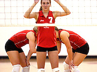 Fauquier's Kathleen Crosby and Nell Davis strategize behind middle blocker Renee Lott (7) during their 3-2 win over Millbrook October 19, 2004 at Fauquier High School in Warrenton, VA.