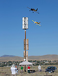 Seth Baker, top, from Las Cruces New Mexico flying Little Miscreant in theSport Champion class races Scott Prewitt from King City California in during the National Championship Air Races at the Reno-Stead Airfield Sunday, Sept. 20, 2015.
