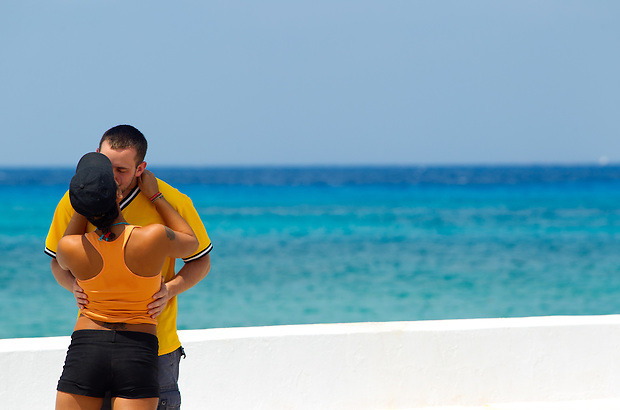 A couple share a kiss at the port of San Miguel de Cozumel, on the Mexican Island of Cozumel.