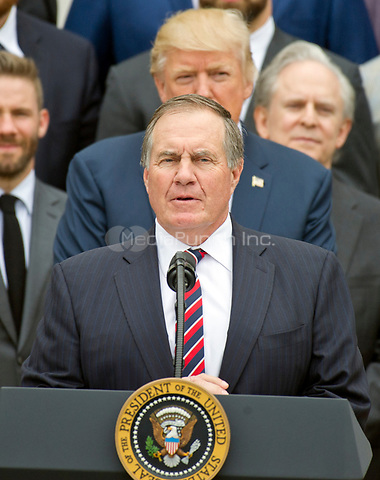 New England Patriots head coach Bill Belichick makes remarks as United States President Donald J. Trump listens from behind during the ceremony welcoming the Super Bowl Champions to the South Lawn of White House in Washington, DC on Wednesday, April 19, 2917.<br /> Credit: Ron Sachs / CNP/MediaPunch<br /> <br /> (RESTRICTION: NO New York or New Jersey Newspapers or newspapers within a 75 mile radius of New York City)