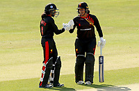 Cordelia Griffiths and Naomi Dattani touch gloves between overs during Sunrisers vs South East Stars, Rachael Heyhoe Flint Trophy Cricket at The Cloudfm County Ground on 13th September 2020