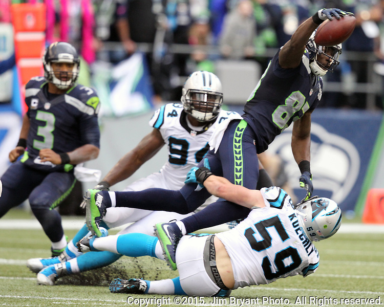 Seattle Seahawks  wide receiver Richardo Lockette (83) catches a shot pass in front of Carolina Panthers linebacker Luke Kuechly (59) at CenturyLink Field in Seattle on October 18, 2015. The Panthers came from behind with 32 seconds remaining in the 4th Quarter to beat the Seahawks 27-23.  ©2015 Jim Bryant Photography. All Rights Reserved.
