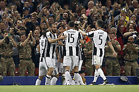 Calcio, Champions League: finale Juventus vs Real Madrid. Cardiff, Millennium Stadium, 3 giugno 2017.<br /> <br /> Juventus&rsquo; Mario Mandzukic, center, celebrates with his teammates after scoring after scoring during the Champions League final match between Juventus and Real Madrid at Cardiff's Millennium Stadium, Wales, June 3, 2017. <br /> UPDATE IMAGES PRESS/Isabella Bonotto