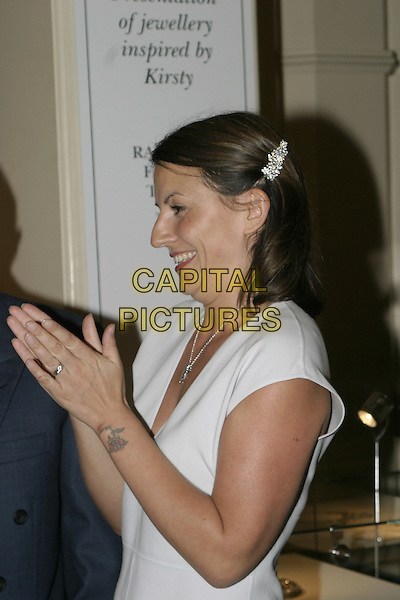 DAVINA McCALL.At Harrods. Goldsmiths tranform Kirsty's drawings into gems. All proceeds will go to raise money for the Kirsty Appeal..August 3rd, 2004.half length, profile, clapping, praying, tattoo, hair accessory.www.capitalpictures.com.sales@capitalpictures.com.© Capital Pictures.