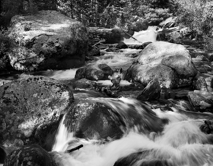 A short stroll from the Wild Basin Trailhead brings one to a close-up view of the Upper Copeland Falls.  The North St. Vrain Creek tumbles over many boulders as it descends from the upper reaches of Rocky Mountain National Park.  In doing so, many fine textures are created in the water and on the surface of the rocks.  Add to that, patches of light and shadows generate various tones throughout the pleasant scene.