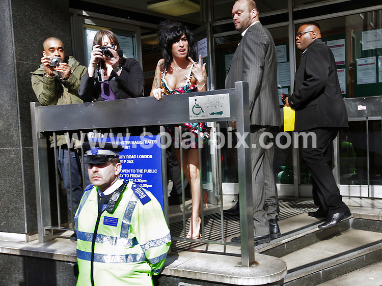 **ALL ROUND PICTURES FROM SOLARPIX.COM**.**NO UK NEWSPAPER PUBLICATION**.**UK MAGAZINE & SUPPLEMENT PUBLICATION ONLY** AND NO PUBLICATION IN AUSTRALIA, FRANCE, GERMANY, ITALY AND SCANDINAVIA** .Amy Winehouse has pleaded not guilty at the City of Westminster Magistrates Court to a charge of common assault over an incident at a charity ball...The 25-year-old singer is accused of assaulting a woman in Berkeley Square, Westminster, central London, on September 26...This pic: Amy Winehouse..JOB REF: 8668 SFE       DATE: 17_03_2009.**MUST CREDIT SOLARPIX.COM OR DOUBLE FEE WILL BE CHARGED**.**ONLINE USAGE FEE GBP 50.00 PER PICTURE - NOTIFICATION OF USAGE TO PHOTO @ SOLARPIX.COM**.**CALL SOLARPIX : +34 952 811 768 or LOW RATE FROM UK 0844 617 7637**