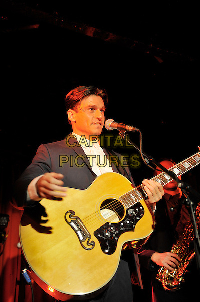 Didier Casnati of Gypsy Queens performing at Madame JoJo, Soho, Lodon, England. .20th September 2012.on stage in concert live gig performance music half length black grey gray suit jacket white shirt guitar singing.CAP/MAR.© Martin Harris/Capital Pictures.