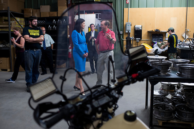 UNITED STATES - AUGUST 26: Sen. Kelly Ayotte, R-N.H., Rokon, which makes two-wheel drive off-road motorcycles, in Rochester, N.H., on Thursday, Aug. 27, 2015. (Photo By Bill Clark/CQ Roll Call)