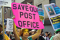 New York Metro Area Postal Union workers and supporters rally near the James Farley Post Office in New York on Saturday, March 17, 2012 to demand that the USPS continue six-day a week mail delivery service. The postal service, which has already cut post office hours as well as other services to meet its budget deficit, is considering elimination of Saturday service which is mandated by Congress. (©Frances M. Roberts)