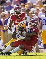 NWA Democrat-Gazette/BEN GOFF @NWABENGOFF<br /> De'Jon Harris (right), Arkansas linebacker, with Kamren Curl, Arkansas cornerback, looking on, tackles Darrel Williams, LSU running back, in the second quarter Saturday, Nov. 11, 2017 at Tiger Stadium in Baton Rouge, La.