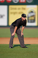 First base umpire Jose Lozada during a game between the Lowell Spinners and the Vermont Lake Monsters on August 25, 2018 at Edward A. LeLacheur Park in Lowell, Massachusetts.  Vermont defeated Lowell 4-3.  (Mike Janes/Four Seam Images)