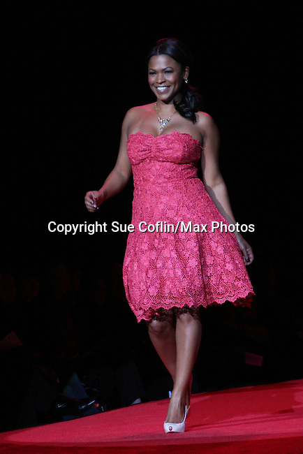 Actress Nia Long (ex-Guiding Light) wearing Tracy Reese walks the runway at The Heart Truth's Red Dress Collection 2009 Fashion Show which raises awareness that heart disease is the #1 killer of women was held during Mercedes -Benz Fashion Week New York Fall 09 on February 13, 2009 in Bryant Park, New York City, NY. This event unites with America's top designers to showcase a colleciton of one-of-a-kind Red Dresses. (Photo by Sue Coflin/Max Photos)