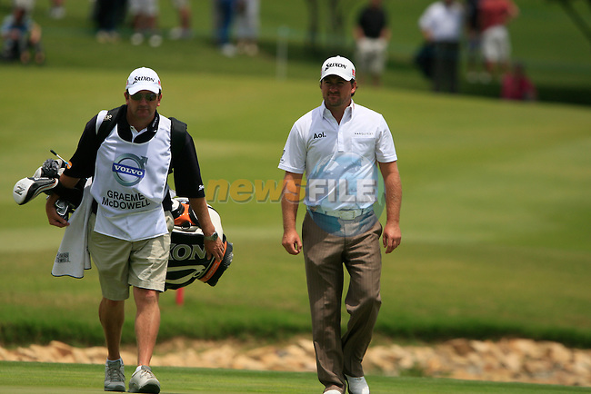 Graeme McDowell (N.IRL) and caddy walk onto the 4th green during the afternoon session on Day 2 of the Volvo World Match Play Championship in Finca Cortesin, Casares, Spain, 20th May 2011. (Photo Eoin Clarke/Golffile 2011)