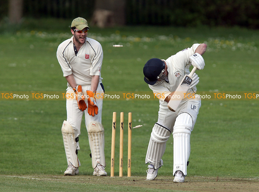 Gidea Park batsman Russ Collard is clean bowled by Moin - Harold Wood CC vs Gidea Park & Romford CC - Cricket Friendly at Harold Wood Park -  18/04/09 - MANDATORY CREDIT: Gavin Ellis/TGSPHOTO - Self billing applies where appropriate - Tel: 0845 094 6026