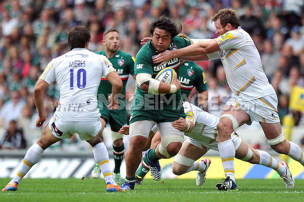 Logovi'i Mulipola is tackled high by Dean Schofield. Aviva Premiership match, between Leicester Tigers and Worcester Warriors on September 8, 2013 at Welford Road in Leicester, England. Photo by: Patrick Khachfe / JMP