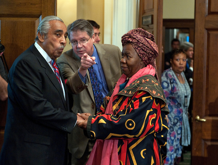 UNITED STATES - NOV 15: Rep. Charles Rangel, D-N.Y., talks with (right) Queen Mother, Dr. Delois Blakely the Community Mayor of Harlem as a committee staffer (center) directs Mr. Rangel to his seat before the start of the House Standards of Official Conduct (Ethics) Committee Adjudicatory Subcommittee hearing to determine whether any alleged ethics violations committed by him can be proven by clear and convincing evidence. The hearing was held in Longworth House Building. (Photo By Douglas Graham/Roll Call)