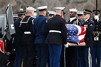 The flag-draped casket of former President George H.W. Bush is carried to a hearse by a joint services military honor guard from the U.S. Capitol, Wednesday, Dec. 5, 2018, in Washington. <br /> CAP/MPI/RS<br /> &copy;RS/MPI/Capital Pictures