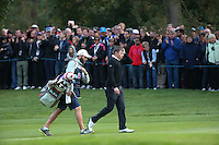 With caddie Tom Ridley Matthew Fitzpatrick (ENG) is applauded all the way to the 18th during the Final Round of the British Masters 2015 supported by SkySports played on the Marquess Course at Woburn Golf Club, Little Brickhill, Milton Keynes, England.  11/10/2015. Picture: Golffile | David Lloyd<br /> <br /> All photos usage must carry mandatory copyright credit (© Golffile | David Lloyd)