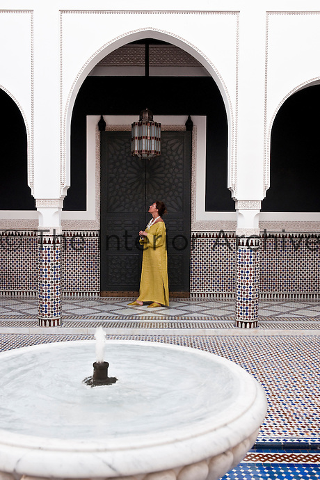 A guest admiring the architectural details of the inner courtyard