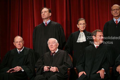 """Washington, DC - September 29, 2009 -- The Justices of the United States Supreme Court posed for their official """"family """" group photo and then allowed members of the media to take photos afterwards at the U.S. Supreme Court in Washington, D.C. on Tuesday, September 29, 2009. Front row, left to right: Associate Justice Anthony M. Kennedy; Associate Justice John Paul Stevens; Chief Justice of the United States John G. Roberts, Jr.  Back row, left to right: Associate Justice Samuel A. Alito, Jr.; Associate Justice Ruth Bader Ginsburg; Associate Justice Stephen G. Breyer..Credit: Gary Fabiano / Pool via CNP"""