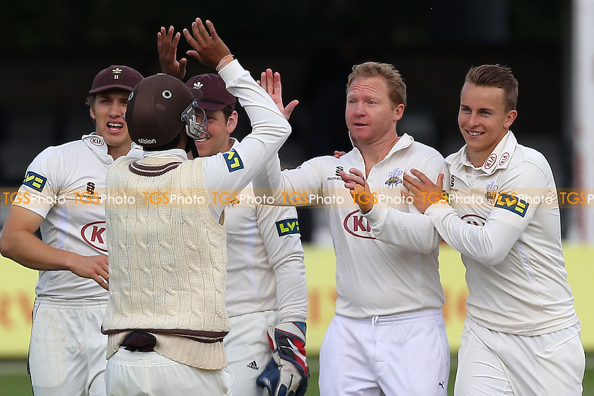 Gareth Batty of Surrey (2nd R) celebrates the wicket of Jaik Mickleburgh - Essex CCC vs Surrey CCC - LV County Championship Division Two Cricket at the Essex County Ground, Chelmsford, Essex - 25/05/14 - MANDATORY CREDIT: Gavin Ellis/TGSPHOTO - Self billing applies where appropriate - 0845 094 6026 - contact@tgsphoto.co.uk - NO UNPAID USE