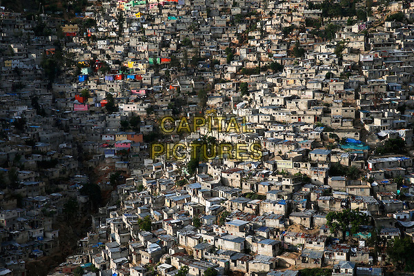 Human (2015) <br /> Jalousie slum bordering the city of Petionville suburb of Port- with -Prince, Haiti (18 &deg; 30 ' 41.57 ' 'N - 72 &deg; 17' 38.80 ' ' W). <br /> Part of the Jalousie neighborhood was repainted in bright colors in 2012. But the houses remain , for the most part free of water and electricity. After the earthquake of 2010, 1.3 million people were left homeless. Many of them have been relocated in camps , but the reconstruction is slow . Across the world , slums are home to over 826 million people ; they welcome about 27 million people each year.<br /> *Filmstill - Editorial Use Only*<br /> CAP/KFS<br /> Image supplied by Capital Pictures