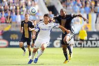 Roger Espinoza (17) of the Kansas City Wizards and Danny Mwanga (10) of the Philadelphia Union go for the ball during a Major League Soccer (MLS) match at PPL Park in Chester, PA, on September 04, 2010.