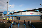 Huddersfield Town 2 Colchester United 0, 12/02/2006. Galpharm Stadium, League Two. Huddersfield Town (Andy Pandy stripes) versus Colchester United (yellow), Coca-Cola League 2 fixture at the Galpharm Stadium, which the home team won 2-0 (1-0). Picture shows the first few Colchester fans queueing outside the away end before kick-off. Photo by Colin McPherson.