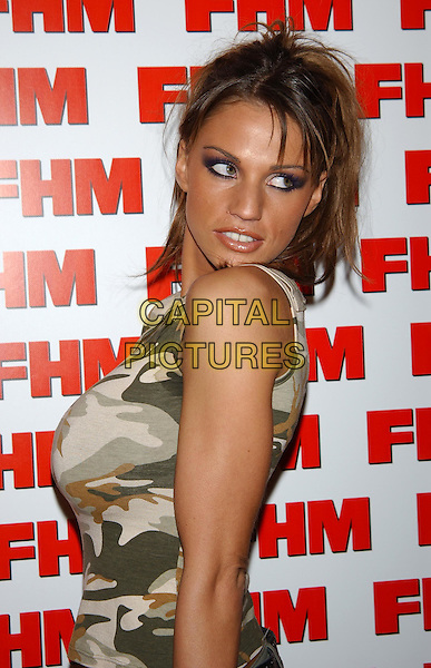 JORDAN.FHM 100 Sexiest Party 2003.Aldwych tube station.sales@capitalpictures.com.www.capitalpictures.com.©Capital Pictures