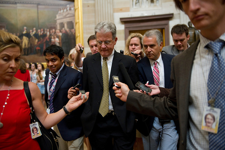 WASHINGTON, DC - July 19: Sen. Tom Coburn, R-Okla., talks to reporters as he walks through Rotunda on his way to the House side before the Senate Republican policy luncheon at the U.S. Capitol. (Photo by Scott J. Ferrell/Congressional Quarterly)