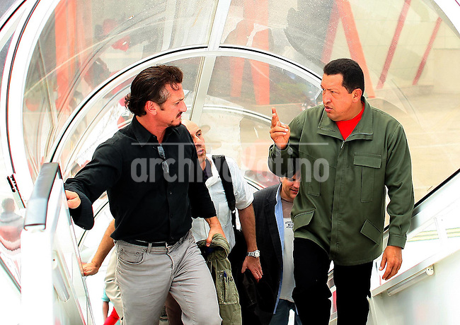 Venezuelan President Hugo Chavez with US actor  Sean Penn during a visit to Cumana, western Venezuela
