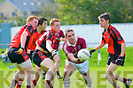 Dromid Declan O'Sullivan gets off his pass despite the attentions of Glenbeigh/Glencar's Pa Kilkenny and Kieran Doyle during their Junior championship semi final clash in Killorglin on Sunday