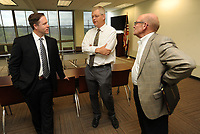 NWA Democrat-Gazette/ANDY SHUPE<br /> Nelson Peacock (left) speaks Tuesday, June 13, 2017, with Rob Smith, and Scott Van Laningham, both of the Northwest Arkansas Council, after being announced as the new president and CEO of the council. Peacock will begin his duties in July after serving as senior vice president of government relations at the University of California Office of the President.