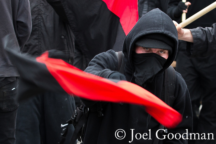 "© Joel Goodman - 07973 332324 . 26/03/2011 . London , UK . A black bloc of protesters carrying black and red anarcho-syndiclist flags walk from Blackfriars to Trafalgar Square . Hundreds of thousands of people attending an anti cuts demonstration under the banner "" March for the Alternative "" in central London , in protest at the coalition government's austerity measures . Photo credit : Joel Goodman"
