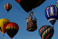 New York, USA. 25 July 2014.  People ride on a balloon during<br />  the 32th annual Balloon festival in Readington, New Jersey. Photo by VIEWpress