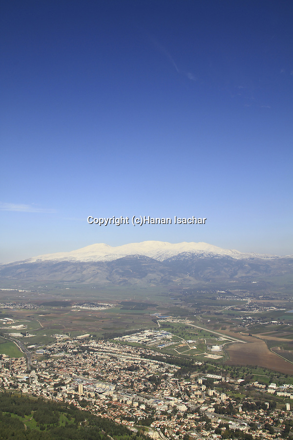 Israel, Upper Galilee, a view of Kiryat Shmona and the Hula valley from Manara Cliff, the Golan Heights and Mount Hermon are in the background