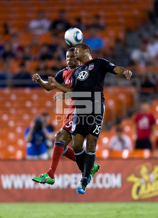 Ethan White (15) of D.C. United goes up for a header with Ryan Johnson (9) of Toronto FC during the game at RFK Stadium in Washington, DC.  D.C. United tied Toronto FC, 3-3.