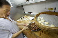 China, Hong Kong S.A.R..Dim Sum at Lin Heung Tea House, a traditional dim sum restaurant..Making of pork dim sum.