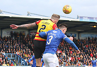 Christie Elliott beats Jordan Marshall in the air in the SPFL Ladbrokes Championship football match between Queen of the South and Partick Thistle at Palmerston Park, Dumfries on  4.5.19.