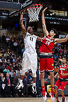 Greg McClinton (11) of the Wake Forest Demon Deacons shoots over Anas Mahmoud (14) of the Louisville Cardinals during first half action at the LJVM Coliseum on January 4, 2015 in Winston-Salem, North Carolina.  The Cardinals defeated the Demon Deacons 85-76.  (Brian Westerholt/Sports On Film)