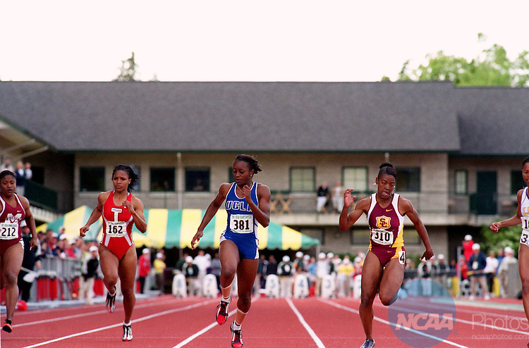 02 June 2001:  Angela Williams of USC (310 - lane 4)   crosses the finish line first to win the Women's 100m  other runners are (L-R) Camille Harper of Miss. State (212), Rachelle Boone of Indiana (162) and Shakedia Jones of UCLA (381) at the 2001 NCAA Division 1 Men's & Women's Outdoor Track & Field Championships held at Hayward Field on the campus of the University of Oregon, Eugene, OR. © Stephen Nowland / NCAA Photos