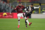 Rodrigo Bentancur of Juventus is challenged by Ante Rebic of AC Milan during the Coppa Italia match at Giuseppe Meazza, Milan. Picture date: 13th February 2020. Picture credit should read: Jonathan Moscrop/Sportimage