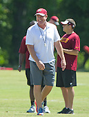 Washington Redskins head coach Jay Gruden smiles as he watches his team participates in the Veteran Minicamp at Redskins Park in Ashburn, Virginia on Tuesday, June 14, 2016.<br /> Credit: Ron Sachs / CNP